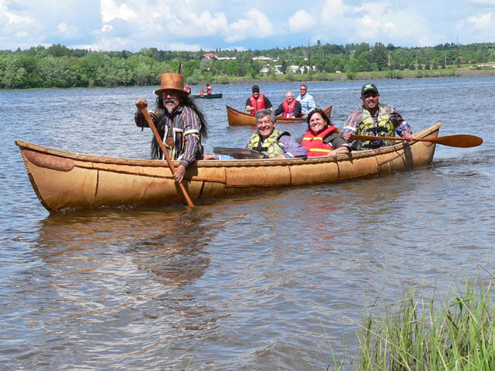 The grandmother canoe, paddled by Wayne and Kim Brooks, with Andrea Bear Nicholas riding amidships  Photo by Daryl Hunter
