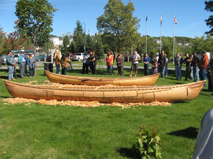 The 19-foot canoe in back, the Grandmother in front